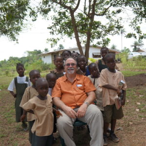 One of our founding members, Joel, with some of the kids at Hope Village